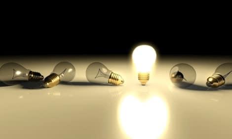 A few lights bulbs lying on a table