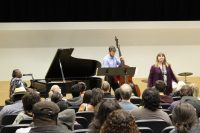 Debbie Lawrence plays the piano, volunteer bass player in the center behind singer Jeanne Walters
