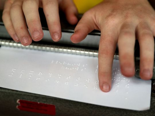 Mitchell Bridwell reads letters that he typed on his Perkins Brailler typing machine, which is used in competition for the Braille Challenge, at his family's home in Pittsboro, Ind., Thursday, July 12, 2018. The 17-year-old recently won the Braille Challenge varsity championship for the second consecutive year at the University of Southern California. Bridwell will be a senior at the Indiana School for the Blind and Visually Impaired this fall. (Photo: Jenna Watson/IndyStar)