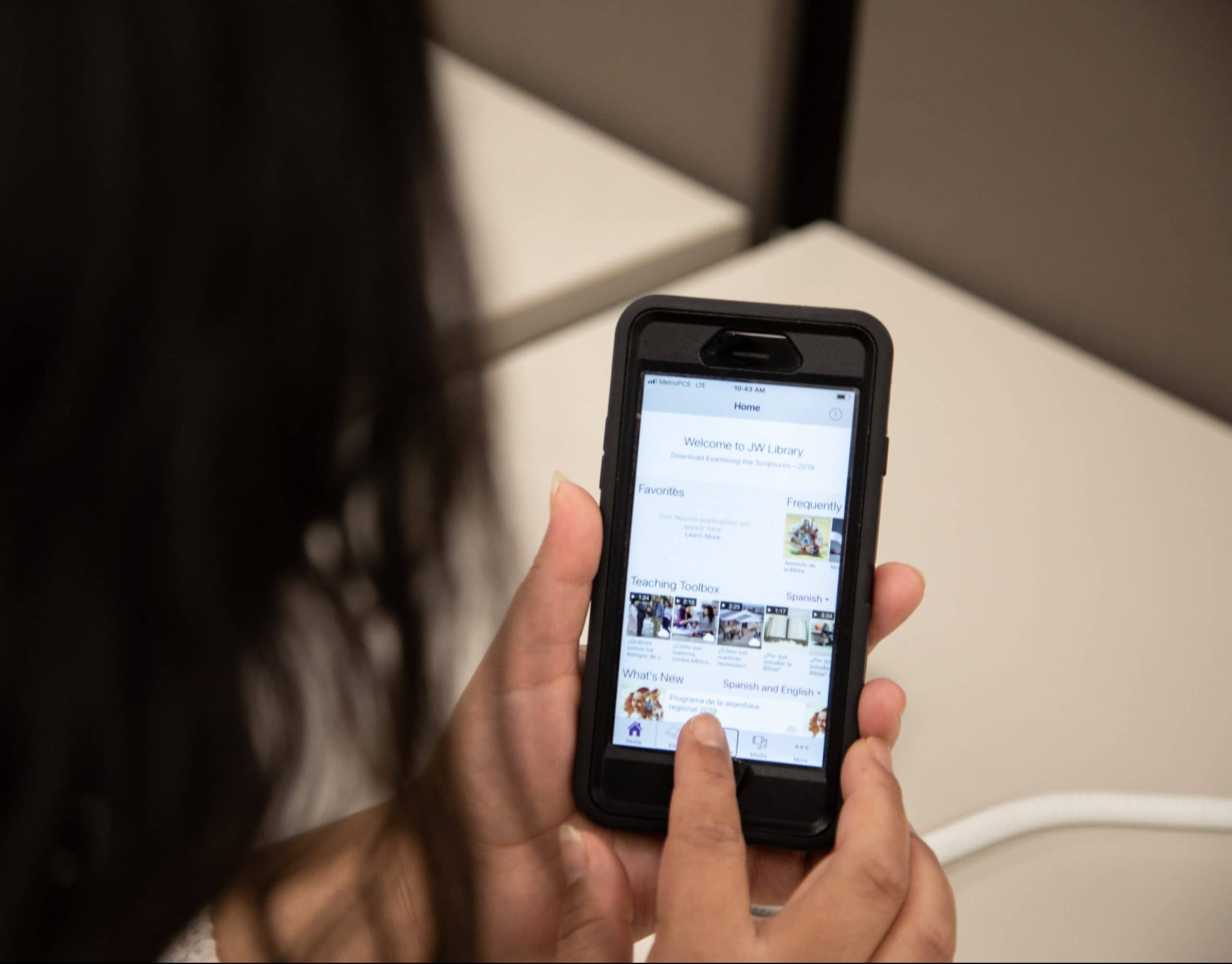 Student scrolls through BARD app on smart phone