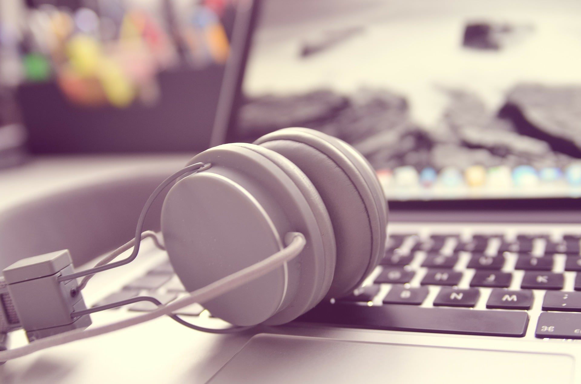 Headphones rest on a laptop