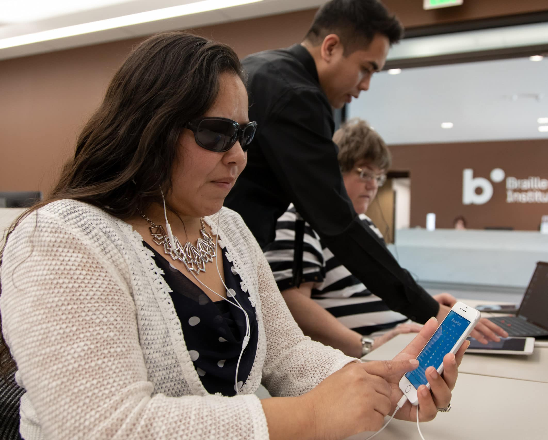 Visually impaired woman using iPhone as assistive device