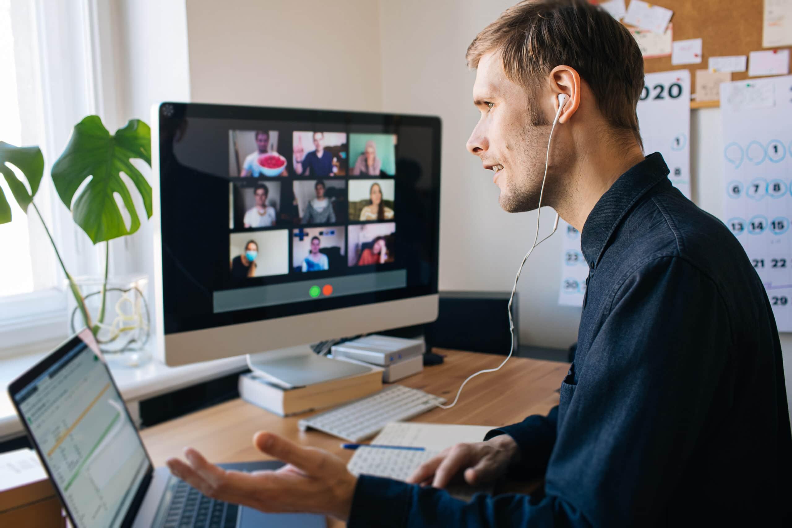Man with earphones is in online meeting