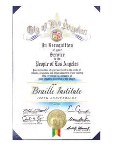 Photo of City of Los Angeles June 2020 certificate recognizing Braille Institute's 100 years of service to the people of Los Angeles signed by Mayor Garceti, 13th District Councilmember O'Farrell and other councilmembers.