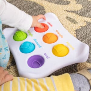 Child hand playing Dimpl Duo